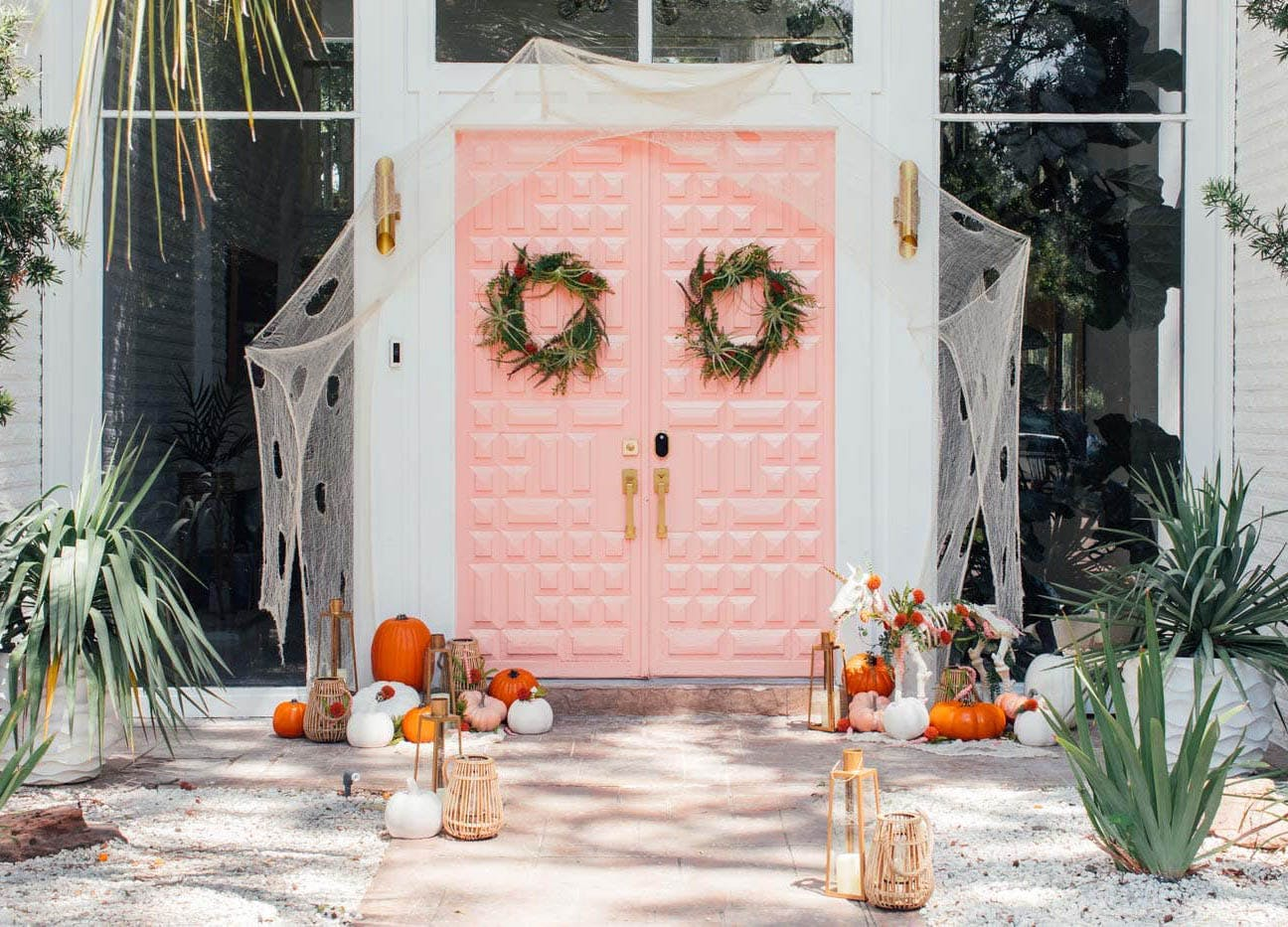 Scary Halloween Door Decorating Ideas from purewows3.imgix.net