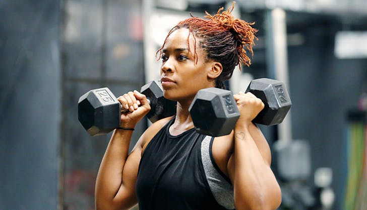 what is a super set young woman lifting weights