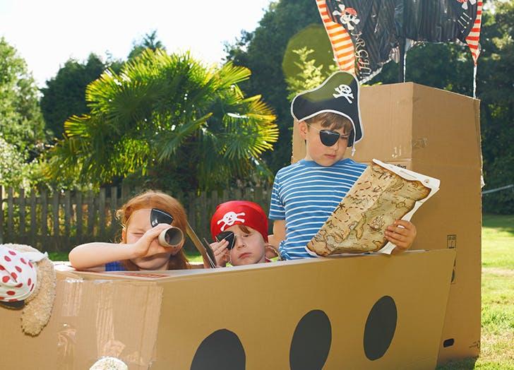kids playing in cardboard box pirate ship