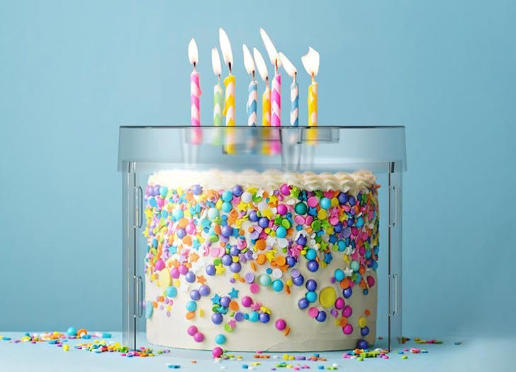 The Top It Cake Shield Lets You Blow Out Birthday Candles Without Spreading Germs to All Your Party Guests