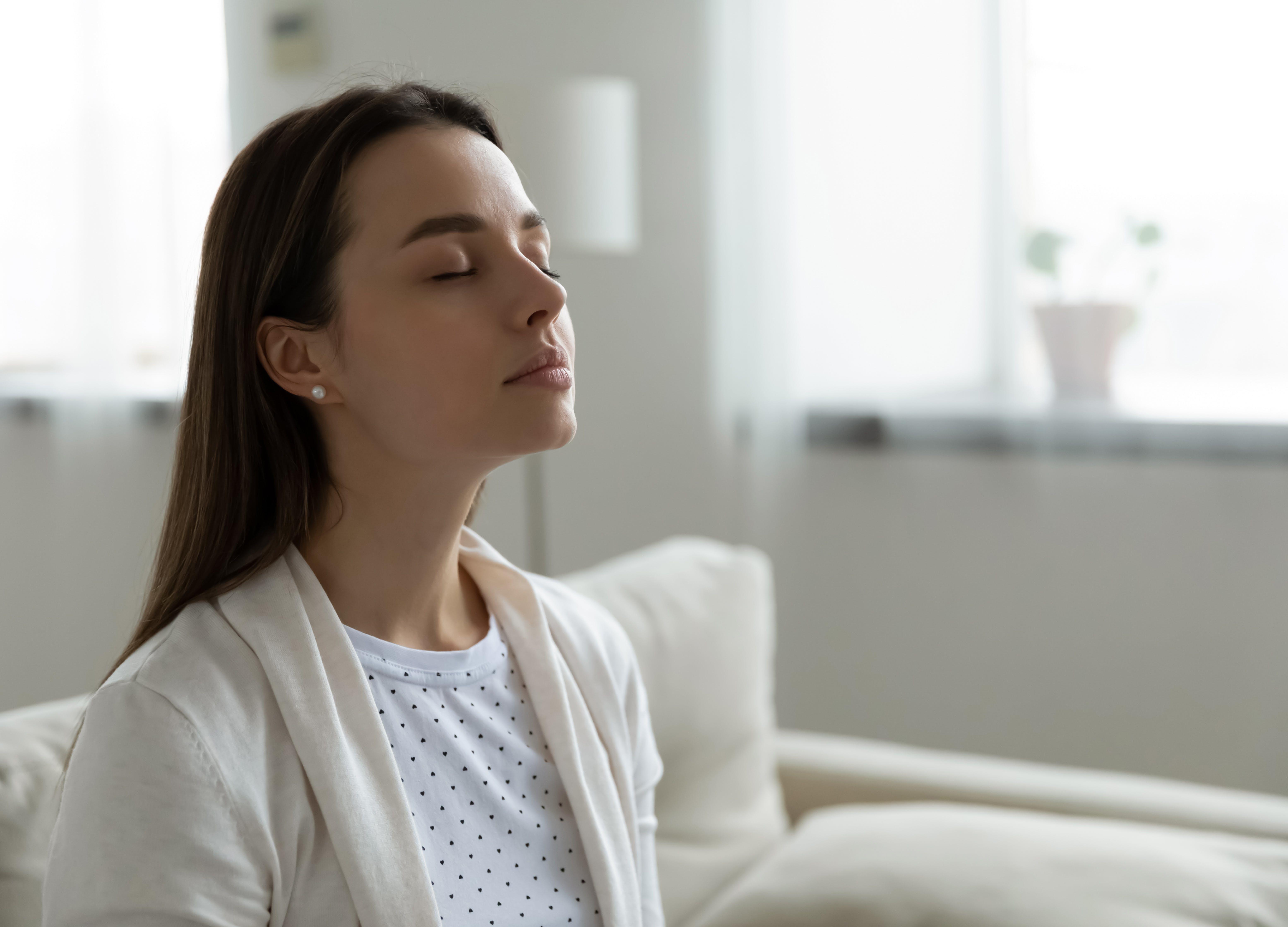 home air quality woman inhaling 728x524