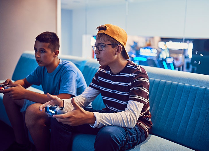 Teens Playing Video