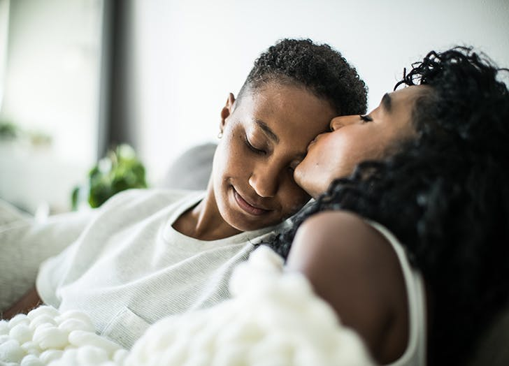how to manifest love couple kissing