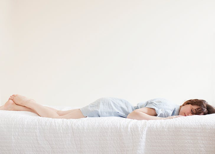 Is It Better to Sleep Without a Pillow? 2 Sleep Experts Weigh In