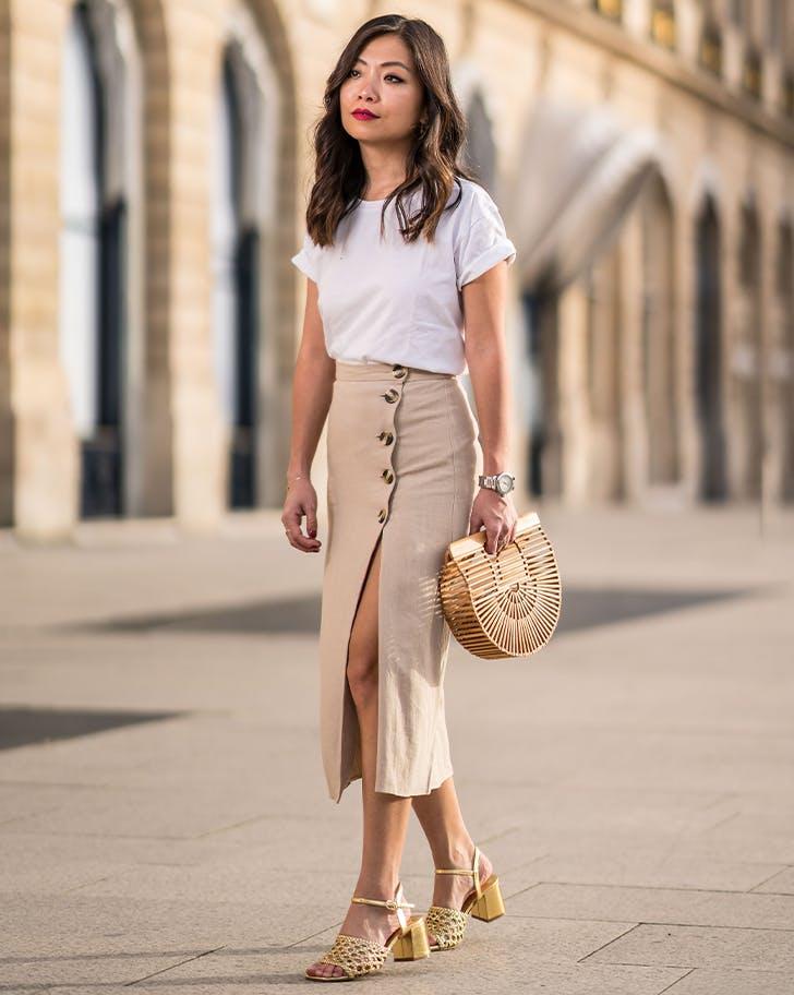 woman wearing a beige pencil skirt